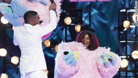 """The Masked Singer"" host Nick Cannon reveals Chaka Khan as the voice under the Miss Monster mask."