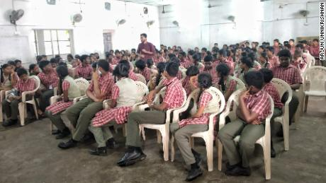 Co-founder of Red Cycle, Arjun Unnikrishnan, stands as he gives an awareness session about menstrual hygiene in St Thomas Matriculation Higher Secondary School in Chennai, Tamil Nadu.