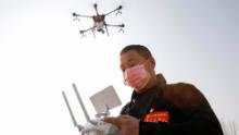 A local resident using a drone spraying disinfectant at a village in China's central Henan province in January.