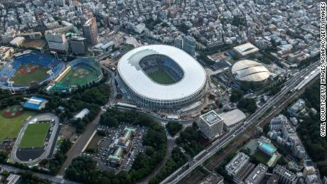 The New National Stadium, the main stadium for the Tokyo 2020 Olympics, and the Tokyo Metropolitan Gymnasium (C-R) are pictured on July 24, 2019 in Tokyo, Japan.