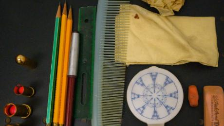 The contents of the bag included a comb, a make-up and 26 cents.