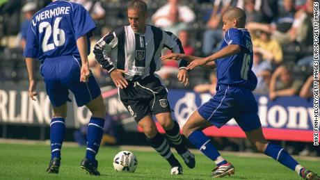 Craig Ramage (center) is seen in action for Notts County against Millwall in 2000.
