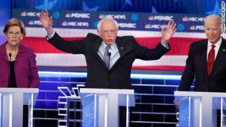 Sanders speaks between Warren and Biden during the Democratic presidential primary debate.