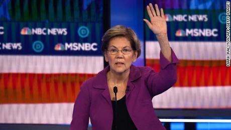 Warren gestures as she speaks during the ninth Democratic primary debate