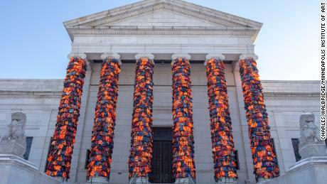 The entrance to a Minneapolis museum has been covered with 2,400 life jackets that refugees once wore