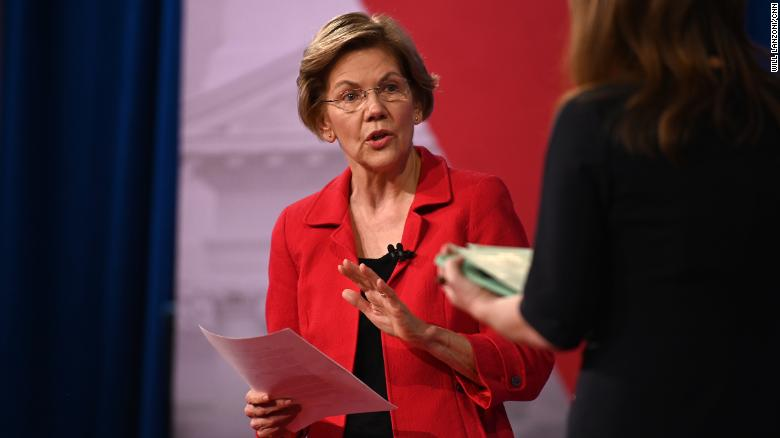 Warren rallies packed Seattle crowd, slams Bloomberg