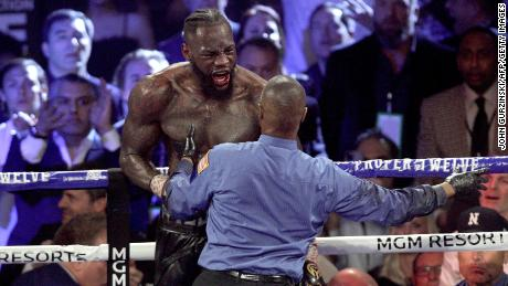 US boxer Deontay Wilder reacts during his World Boxing Council (WBC) Heavyweight Championship Title boxing match against British boxer Tyson Fury at the MGM Grand Garden Arena in Las Vegas on February 22, 2020.
