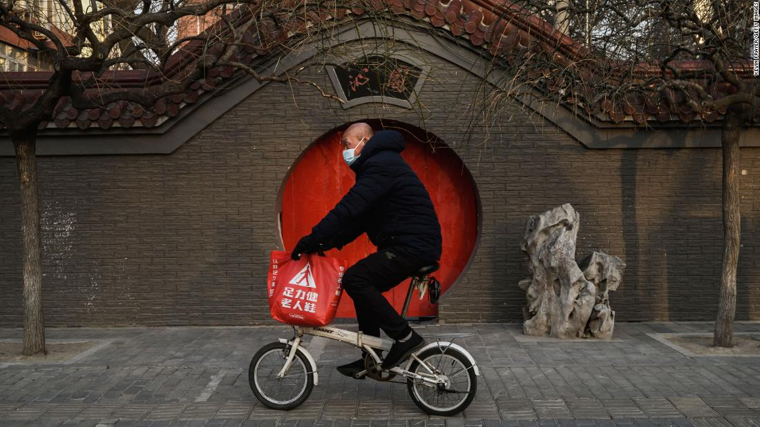 A man rides his bike in Beijing on February 23.