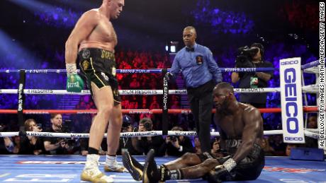 Tyson Fury knocks down Deontay Wilder in the fifth round of their fight.
