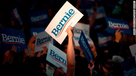 Supporters of Democratic presidential hopeful Vermont Senator Bernie Sanders cheer during a rally at Houston University in Houston, Texas on February 23, 2020.
