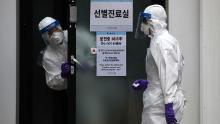 A disinfection professional wears protective gear and sprays anti-septic solution at the National Assembly in Seoul, South Korea, on on February 24.