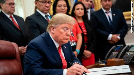 President Donald Trump signs an executive order establishing the Task Force on Missing and Murdered American Indians and Alaska Natives, last November.