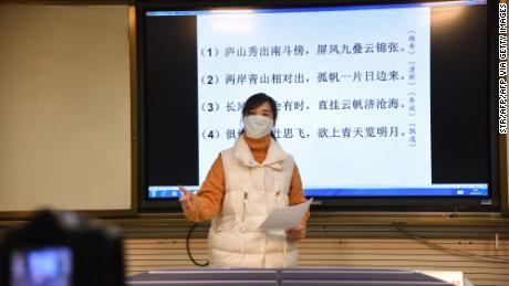 A teacher gives a lecture in front of a camera during an online class at a middle school in Donghai in China's eastern Jiangsu province on February 17, 2020.