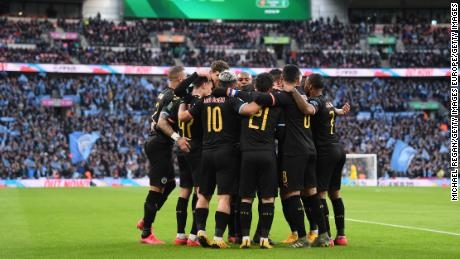 Manchester City players celebrate the first goal scored by Aguero.