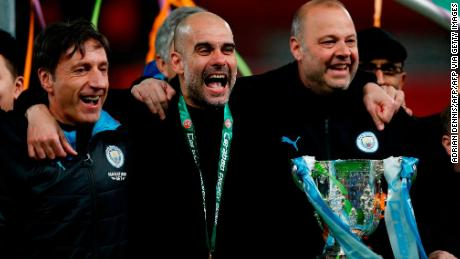Guardiola celebrates with his backroom staff.