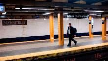 A man wears a face mask on a subway plattform in Flushing, Queens.