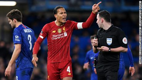 Virgil van Dijk of Liverpool remonstrates with referee Chris Kavanagh during the defeart to Chelsea.