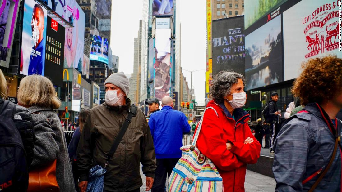 People wear face masks in New York's Times Square on March 3. New York reported its first case of coronavirus two days earlier.