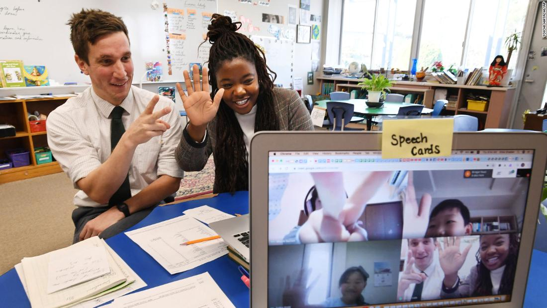 Teachers at the Nagoya International School in Japan conduct an online class for students staying at home as a precaution against the spread of coronavirus.