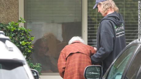 Dorothy Campbell, 88, visits her 89-year-old husband Gene through a window.