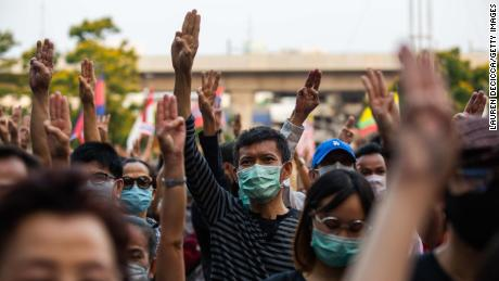Thai people protest against the government with a three finger salute at Kasetsart University February 29, 2020 in Bangkok.