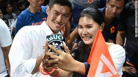 Future Forward Party leader Thanathorn Juangroongruangkit takes a selfie with a supporter in Bangkok on March 22, 2019.