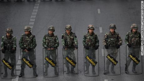 Thai soldiers deployed on a road leading to Victory Monument, the site of recent anti-coup protests on May 30, 2014 in Bangkok.