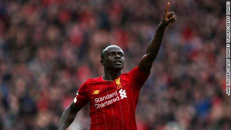 Sadio Mane celebrates after scoring his team's second goal during the Premier League match against Bournemouth at Anfield on March 07, 2020.