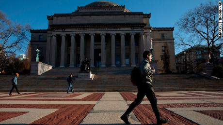 A man walks past Low Library on the Columbia University campus, Monday, March 9, 2020, in New York.