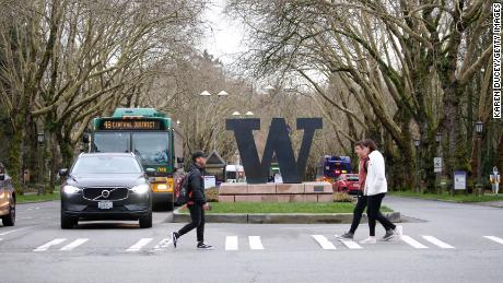 Students at the University of Washington are on campus for the last day of in-person classes on March 6, 2020 in Seattle, Washington.