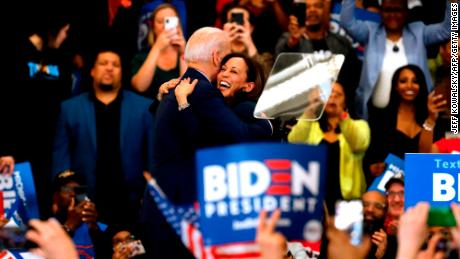California Senator Kamala Harris (C) hugs Democratic presidential candidate former Vice President Joe Biden after she endorsed him at a campaign rally at Renaissance High School in Detroit, Michigan on March 9, 2020.
