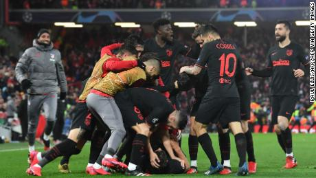 Atletico Madrid celebrate Marcos Llorente's second goal.