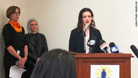 Elizabeth Mitchell, an attorney for the Los Angeles Alliance for Human Rights, announces the filing of a federal lawsuit at the Midnight Mission in Los Angeles Tuesday.