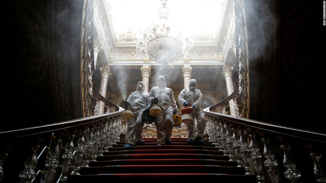 Workers in protective suits disinfect Istanbul's Dolmabahce Palace on March 11.