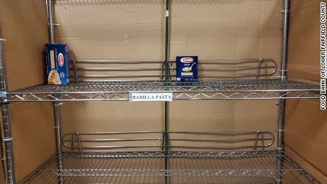 Lone boxes of pasta sit on the shelves at the Food Bank of Lower Fairfield County in Connecticut.