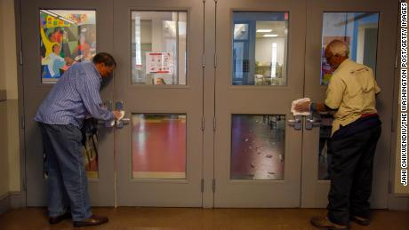 Volunteers at Central Union Mission men's homeless shelter disinfect surfaces in Washington DC.