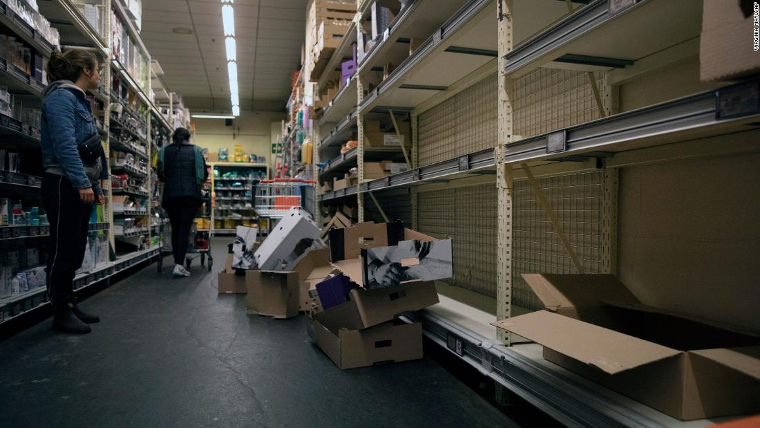 A woman looks at an empty bread aisle in Antwerp, Belgium, on March 13.