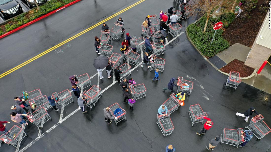 "Hundreds of people lined up to enter a Costco in Novato, California, on March 14. Many people have been stocking up on food, toilet paper and other items. As a response to <a href=""https://www.cnn.com/2020/03/09/health/toilet-paper-shortages-novel-coronavirus-trnd/index.html"" target=""_blank"">panic buying,</a> retailers in the United States and Canada have started limiting the number of toilet paper that customers can buy in one trip."