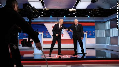 Former Vice President Joe Biden and Vermont Sen. Bernie Sanders participate in the Democratic debate in Washington, on Sunday, March 15.