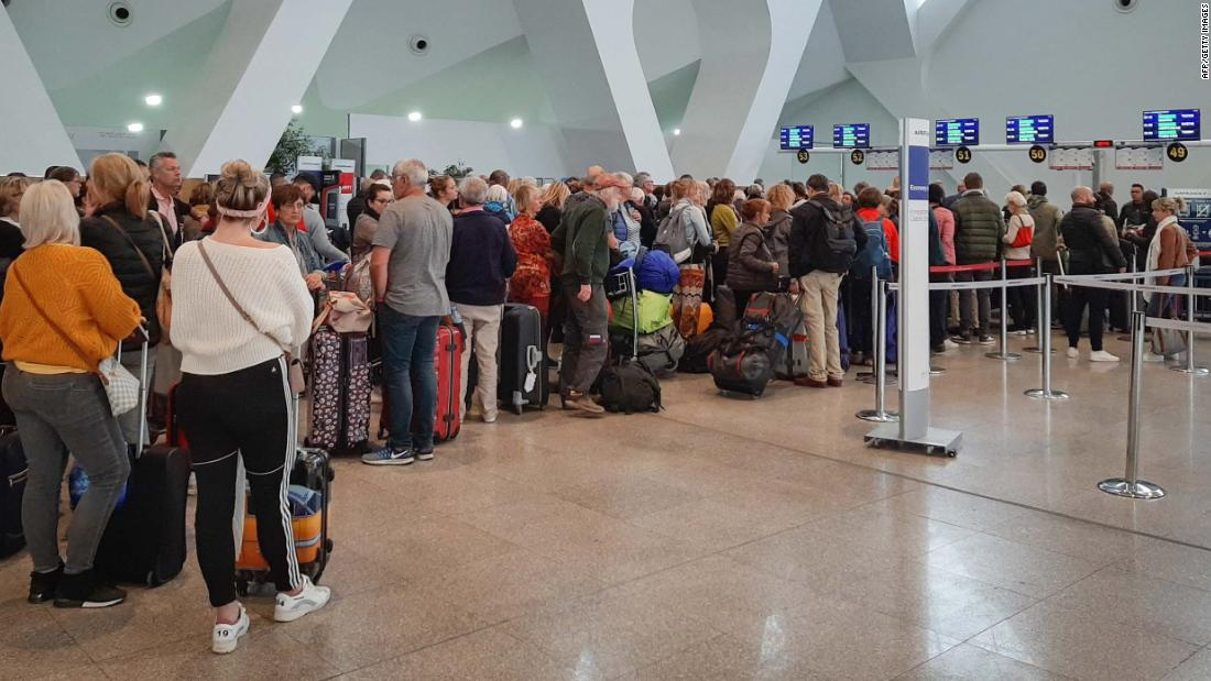 Passengers wait for their flights at Marrakesh Airport in Morocco on March 15.
