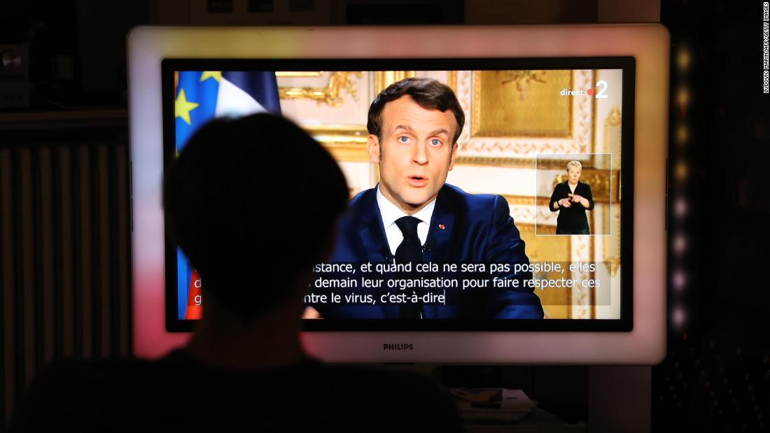 "French President Emmanuel Macron is seen on a screen in Paris as he announces new coronavirus containment measures on March 16. <a href=""https://www.cnn.com/world/live-news/coronavirus-outbreak-03-17-20-intl-hnk/h_da63d65d14fcffbc7105f1a287478a55"" target=""_blank"">France has been put on lockdown,</a> and all nonessential outings are outlawed and can draw a fine of up to €135 ($  148). Macron also promised to support French businesses by guaranteeing €300 billion worth of loans and suspending rent and utility bills owed by small companies."