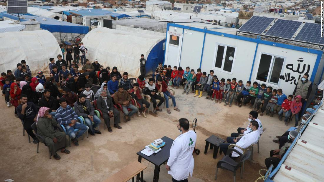 Displaced families near Atme, Syria, attend a workshop aimed at spreading awareness about the coronavirus.