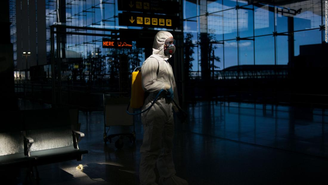 A member of Spain's Military Emergencies Unit carries out a general disinfection at the Malaga airport on March 16.