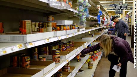 Shoppers are stocking up on canned foods and other shelf-stable products. (Jeremy Hogan/Echoes Wire/Barcroft Media/Getty Images)