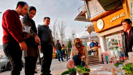 People view items for sale ahead of Nowruz outside the Tajrish Bazaar in Iran's capital Tehran on March 12, 2020.