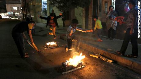 Iranians typically jump over bonfires to ward away sickness before Nowruz. This year, as traditions are transformed by the coronavirus, many have resorted to jumping over candles in their houses.