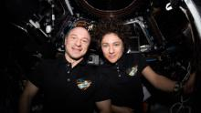 "NASA astronauts Andrew Morgan and Jessica Meir pose for a portrait inside the cupola, the International Space Station's ""window to the world."" The two Expedition 62 Flight Engineers were participating in the capture activities of Northrop Grumman's Cygnus cargo craft."