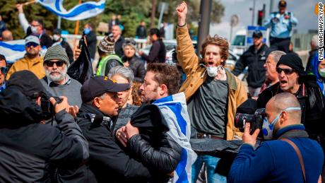 Protesters gathered outside the Knesset Thursday.
