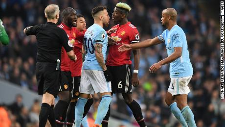 Manchester United and Manchester City players clash during their Premier League match.