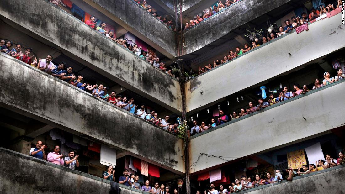 People clap from balconies to show their appreciation for health care workers in Mumbai, India.